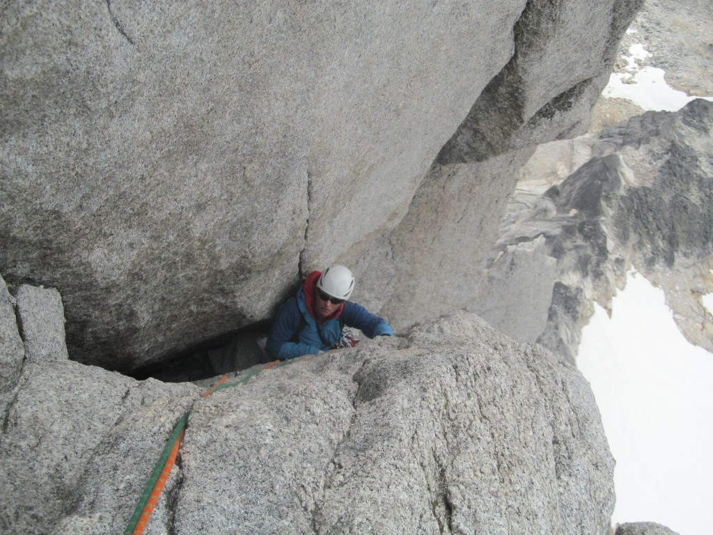 Anna exiting the squeeze chimney of pitch 12 on the Beckey-Chouinard.